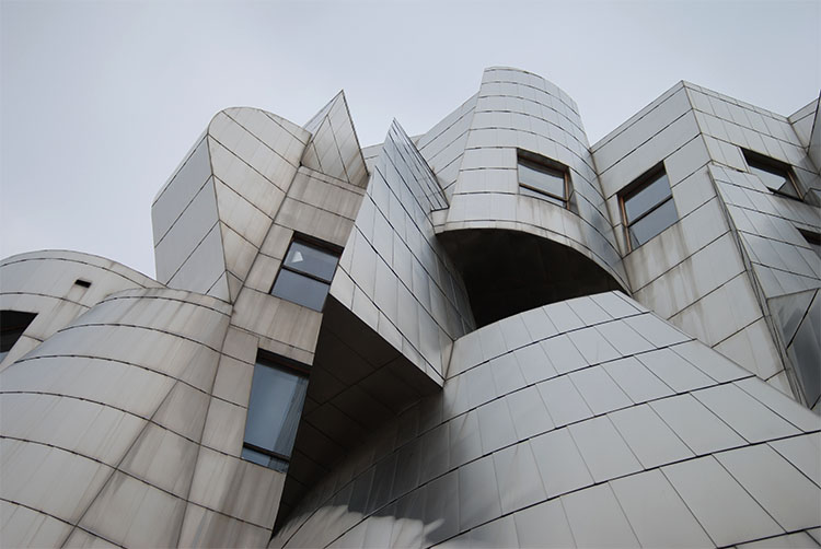 The swirling forms of the West-facing facade of the Weisman Art Museum on the University of Minnesota - Twin Cities campus in Minneapolis rises above you. The many different shapes and forms created are supposed to look like a fish jumping up a waterfall, according to the building's architect, Frank Gehry.