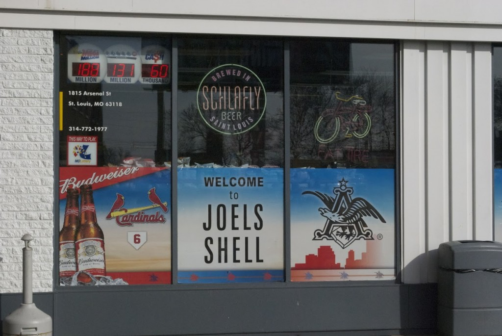 Schlafly alongside Budweiser represented by a local gas station window.