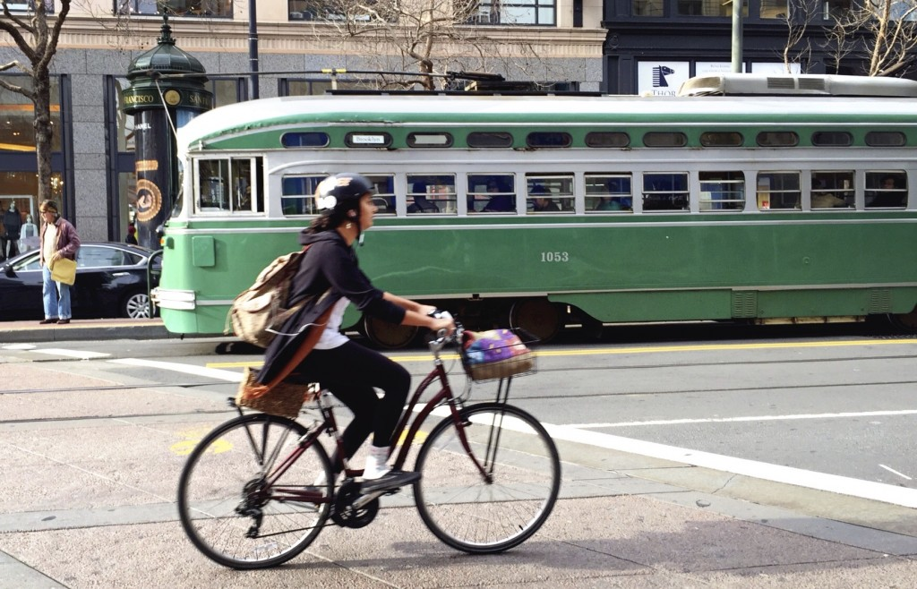 Commuter cyclist on Market street, San Francisco, California.