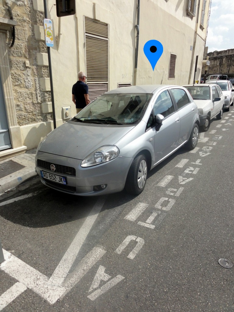 Carsharing cars parked on street in Avignon, France