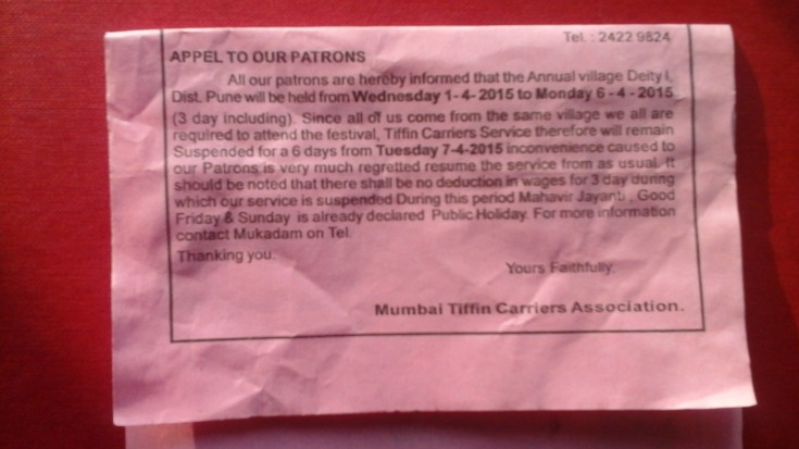 A notice for a pause in Dabba services from the Mumbai Association of Tiffin Carriers. The notice speaks of the Dabbawallas pausing service inorder to attend an important festival occuring at a specific village in Maharashtra. The festival and holiday period for them coincides with Good Friday, a national holiday in India.