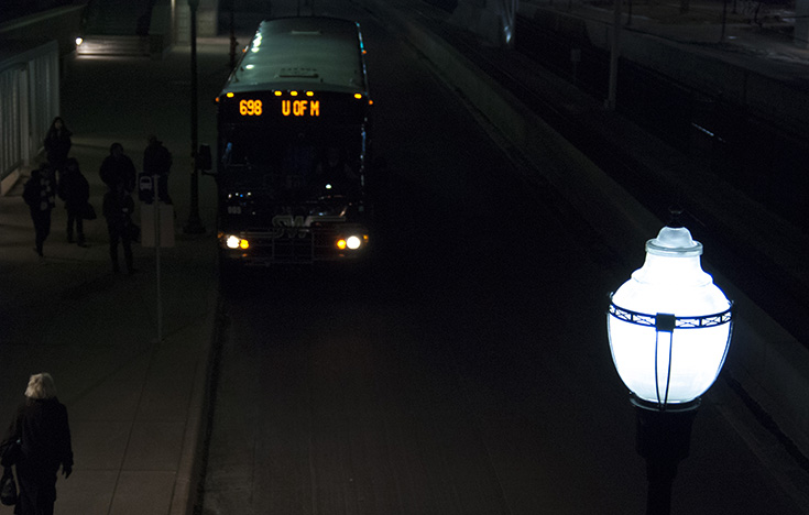 A city bus pulls up to a group of awaiting riders in Minneapolis, Minnesota.