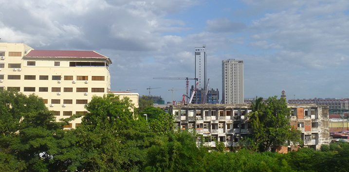 Views of new and old buildings among the vegetation of Phnom Penh, Cambodia