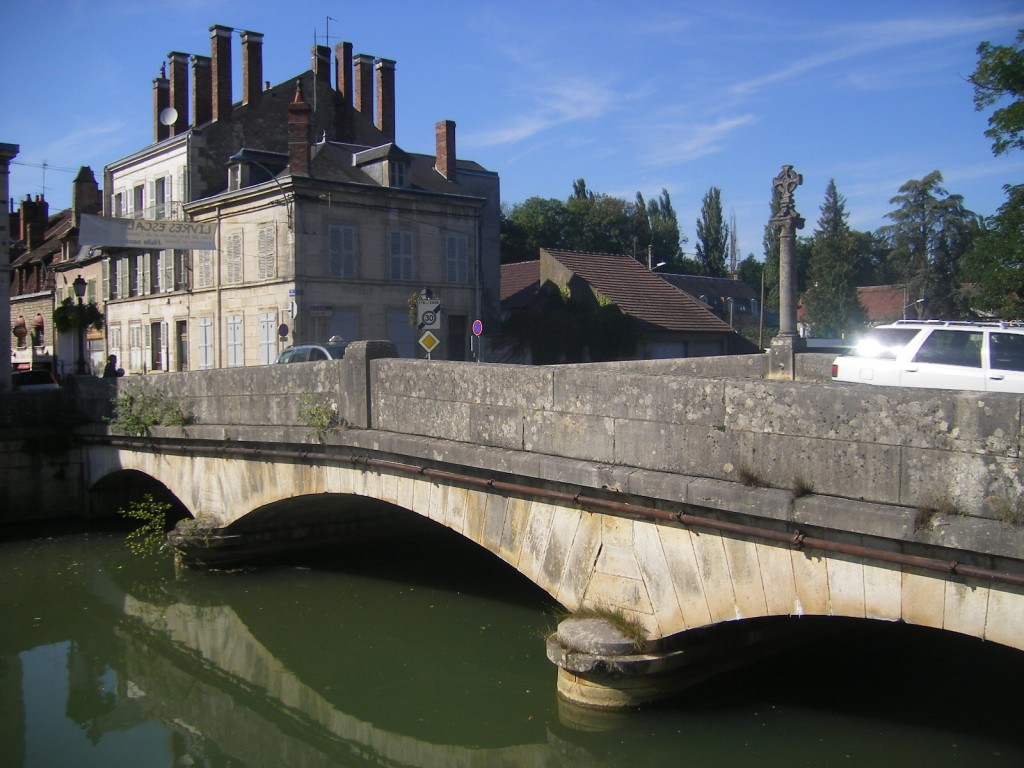 View looking across bridge and river in Clamecy, France