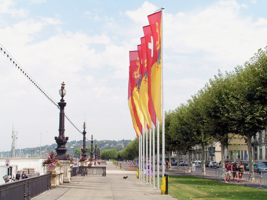 Harbor, path, pedestrians, and cars along Gustave-Ador Embankment, Geneva, Switzerland