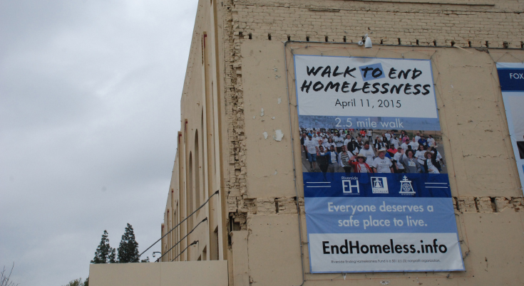 Sign advertising the walk to end homelessness in Downtown Riverside, CA