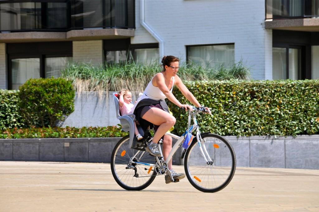 Mother and Child Bike through Belgian Neighborhood