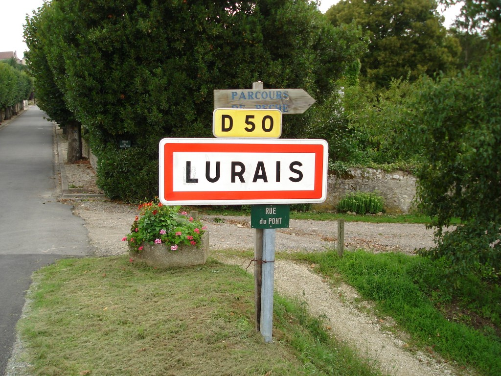Sign pointing towards entry to Lurais, France