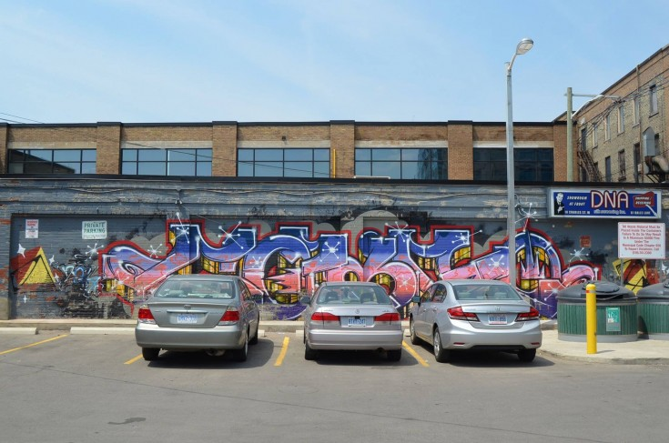 Image of urban graffitti behind Cafe Pyrus in Kitchener, Canada