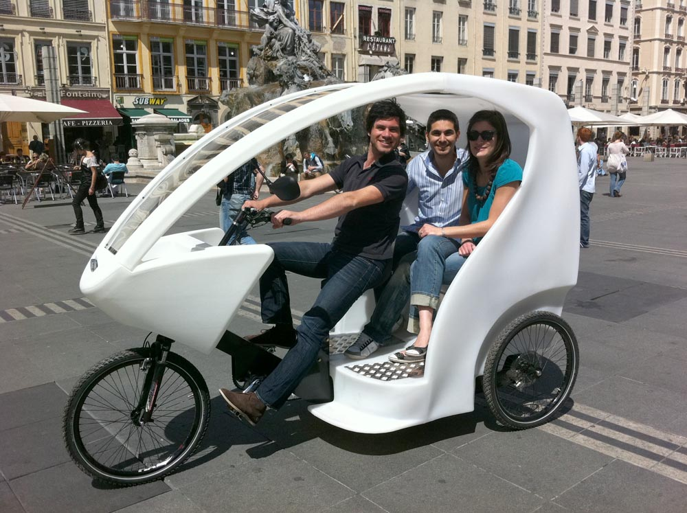 Cyclopolitian bike taxi with passengers in Lyon, France