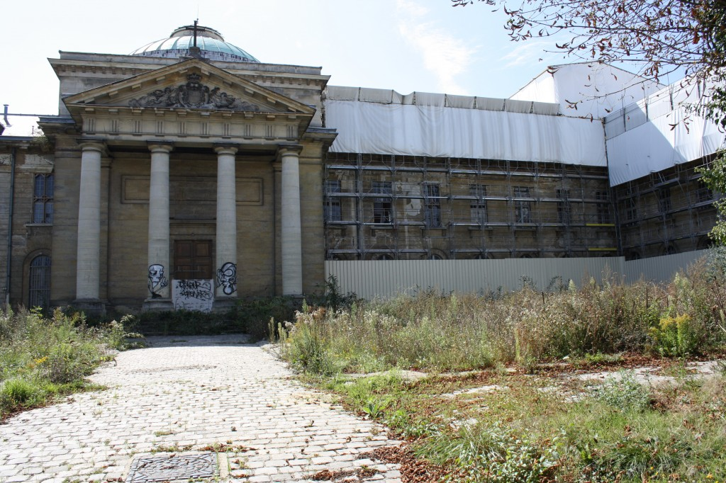 Versailles, France: Richaud Royal Hospital Renovation , front of building still covered in graffiti from years of abandon, scaffolding can be seen on right half of building for restoration
