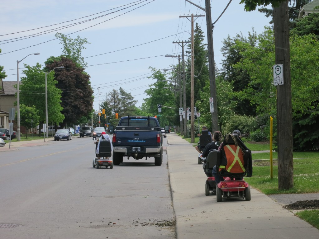 Motorized Wheelchair users ride in the direction of traffic