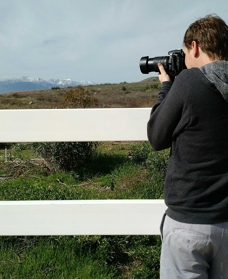 Picture of Taylor York photographing a panoramic shot of the Inland Empire, taken from Highland, CA