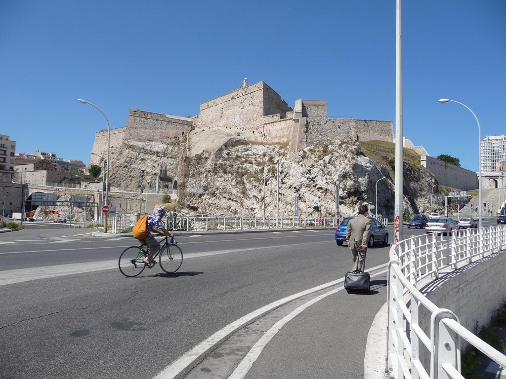 vVeux Port de Marseille, France bicyclist and pedestrian