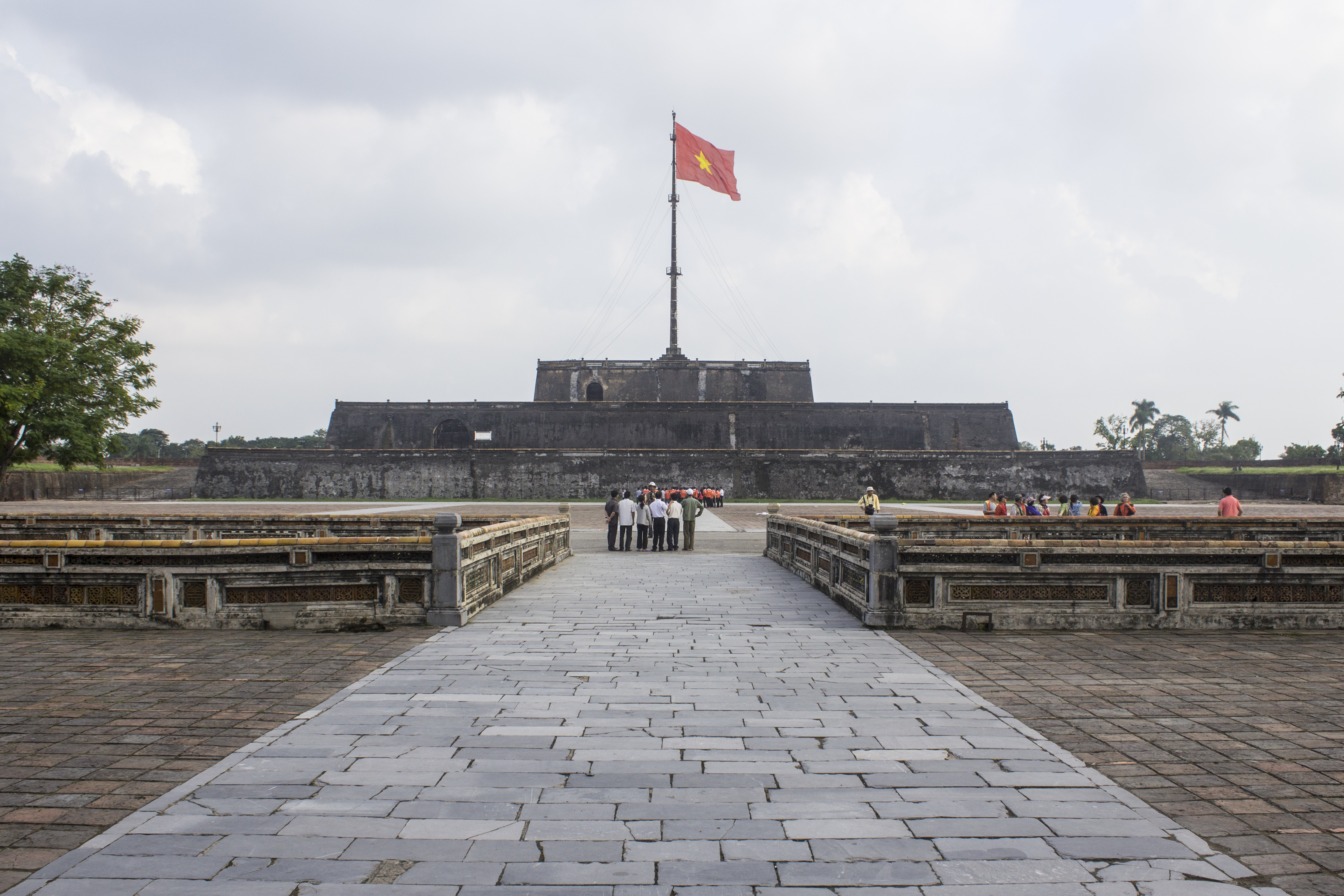 The Vietnamese flag flying proudly above the former palace of the emperor, Hue, Vietnam