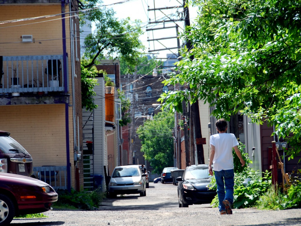 Alley with man walking in old Limoilou, Quebec