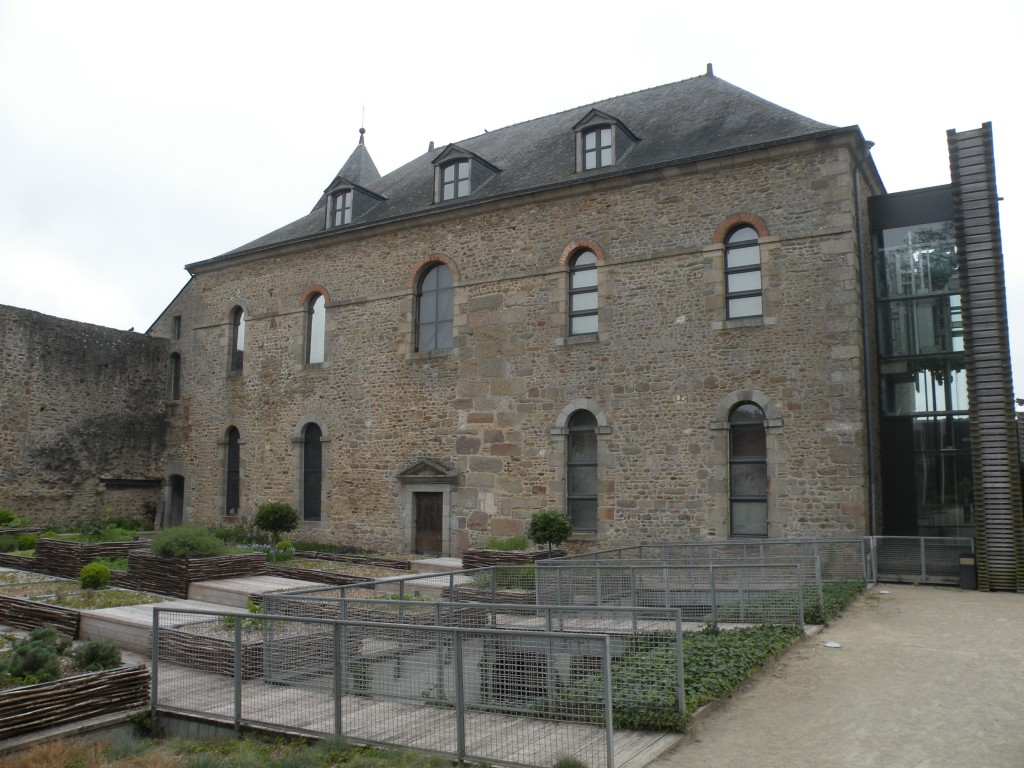Château de Mayenne facade shows modern addition containing accessible elevator and entrance,  Mayenne, France