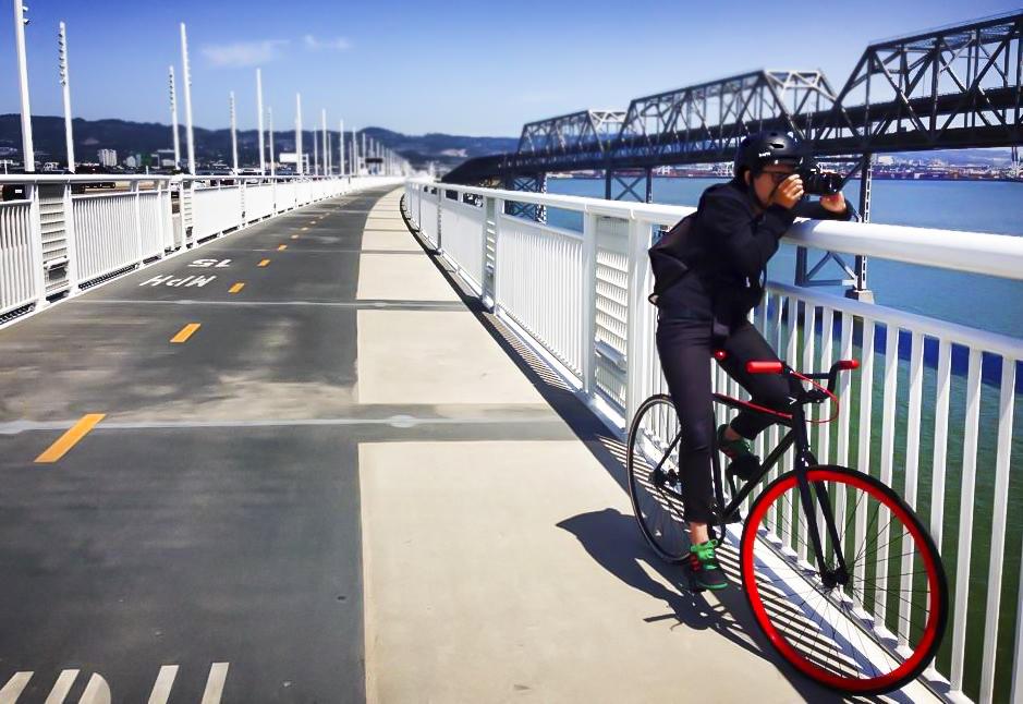 On the Bay Bridge bike path taking photos, San Francisco, California