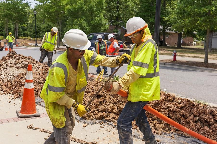Construction crews started digging up and putting down the infrastructure for Google Fiber in the Triangle, Raleigh-Durham metropolitan area, North Carolina, United States