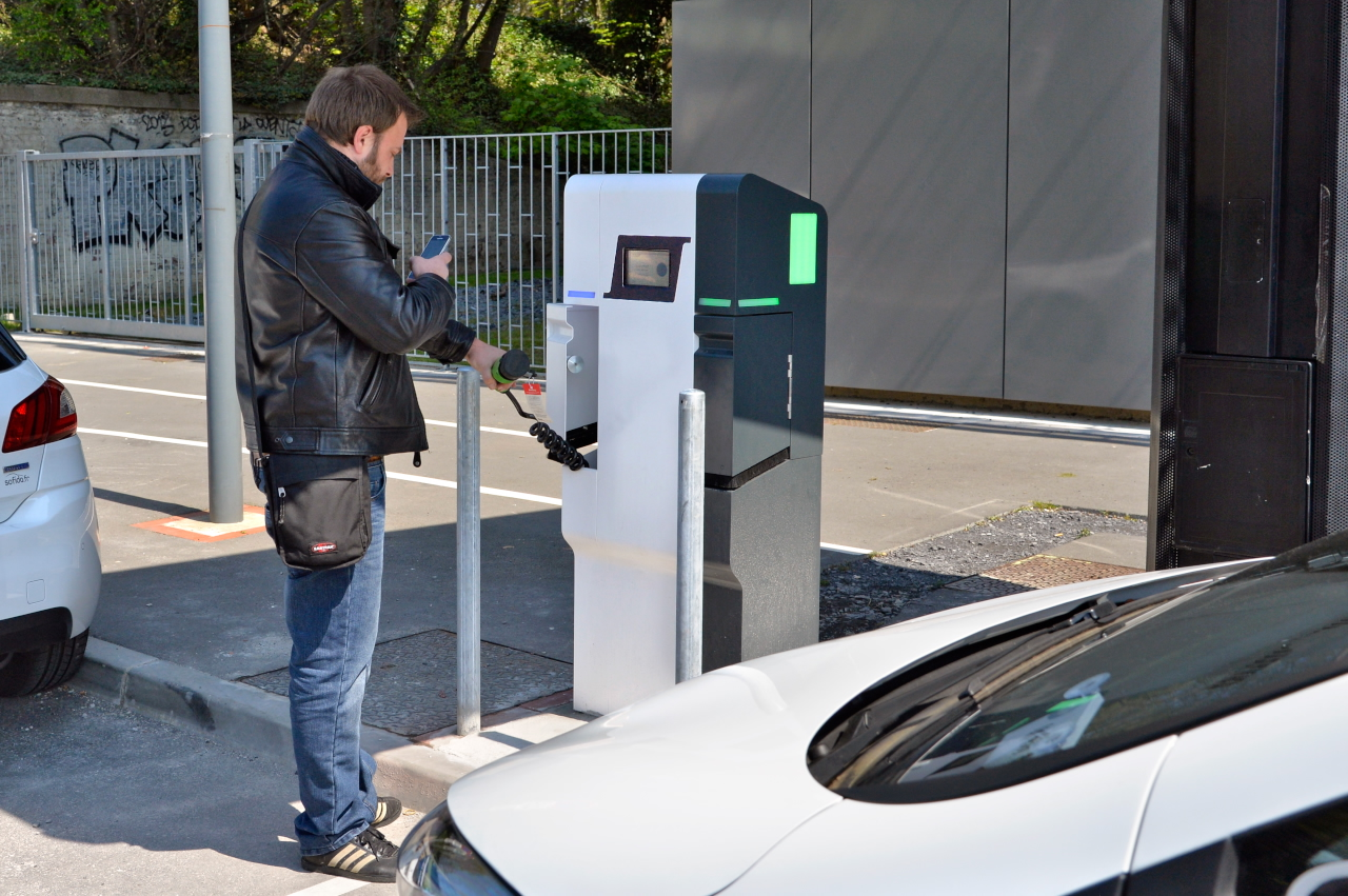 Person Filling up at a Charge Station in Lille, France