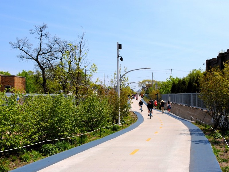 The 606 Trail on the North Side of Chicago is pictured. Several cyclists are seen approaching from the distance.