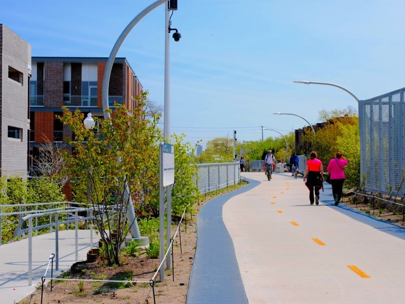 The 606 Trail on the North Side of Chicago is pictured. There is a path for pedestrians and cyclists with native plants nearby.