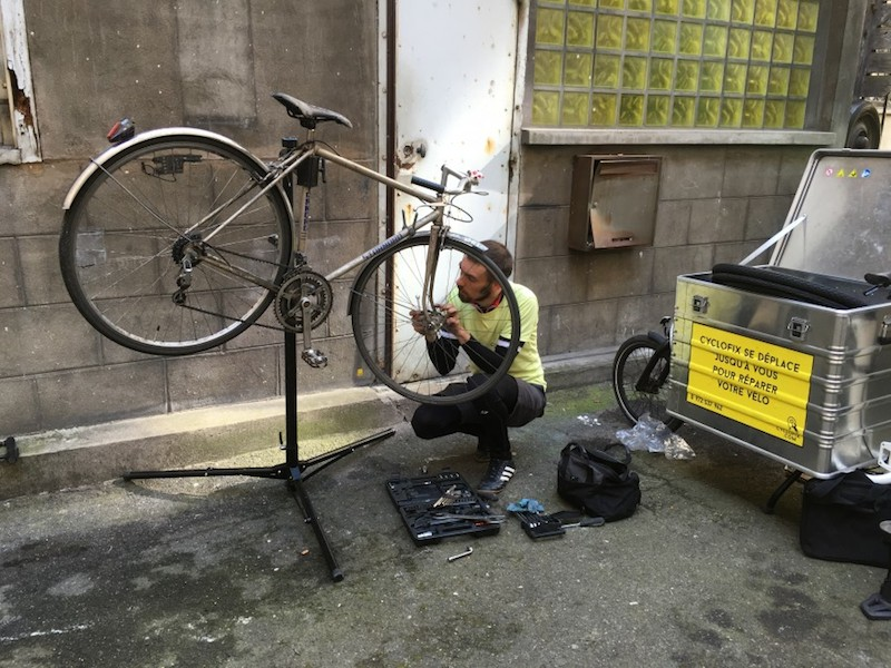 Bike being fixed in Paris, France by Cyclofix