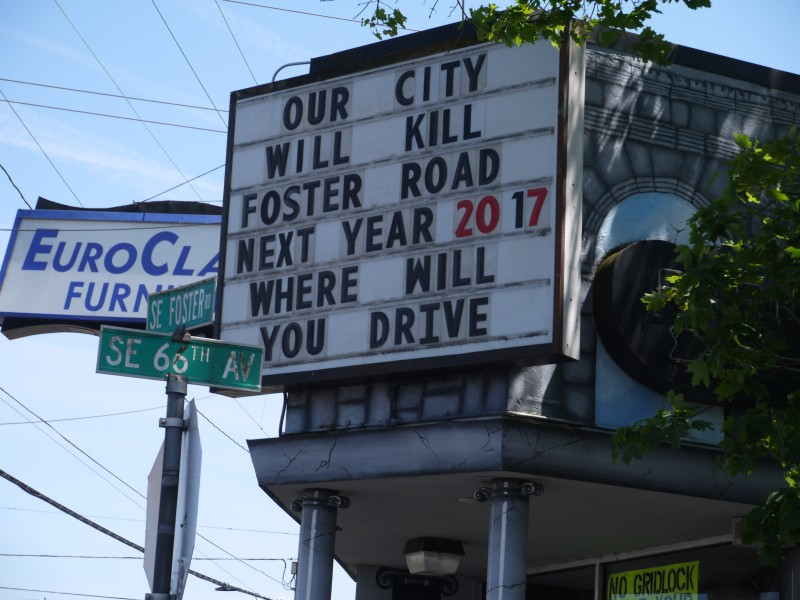 "A business along Foster Road uses its sign to warn commuters of potential impacts from the road diet. The sign reads ""Our city will kill Foster Road Next Year 2017 where will you drive"""
