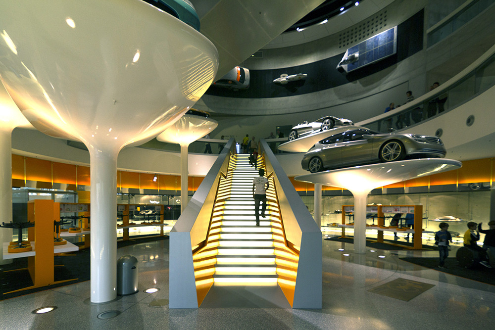 Classic Mercedes Benz cars on elevated display platforms for visitors to gaze at inside the Mercedes Benz Museum in Benzviertel, Stuttgart, Germany