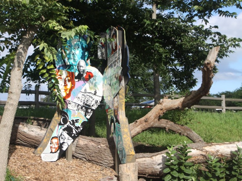 Sankofa for the Earth is one of the Gathering Spaces installed on the Burnham Wildlife Corridor on the South Side of Chicago. A colorful installation made with collage and mosaic is in a natural setting.