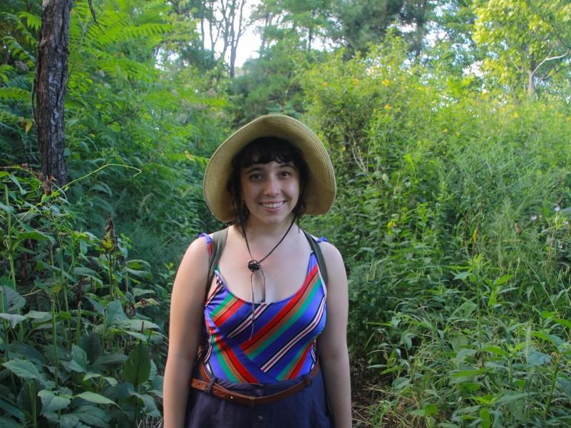 Hannah Flynn stands in the Burnham Wildlife Corridor by Lake Michigan.