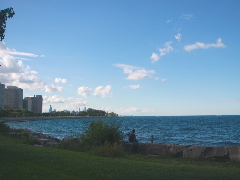 At Promontory Point Park, the Chicago skyline can be seen past Lake Michigan.