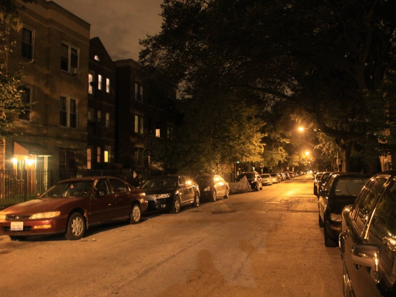 A residential street in Chicago at night, masked in the ubiquitous orange glow.