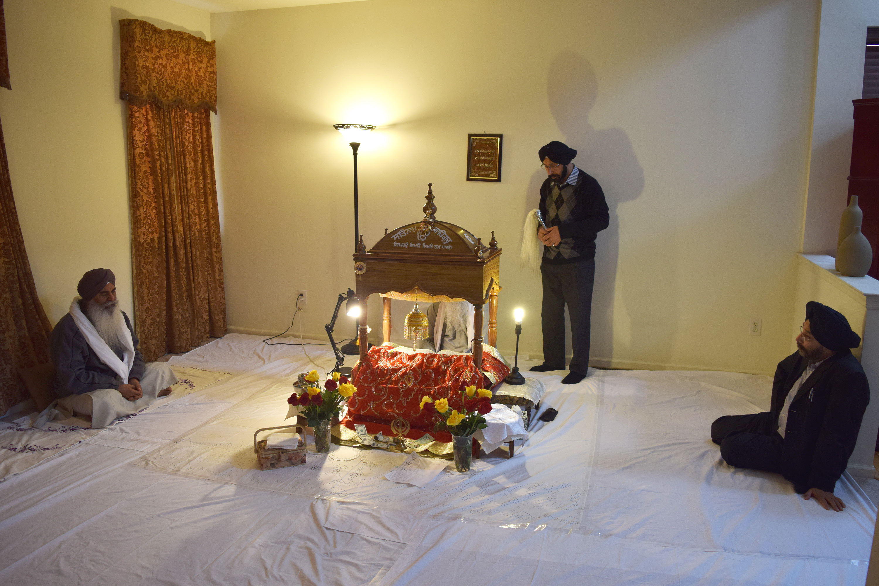Asian-Americans who practice a religion may translate this practice into their own home by converting a bedroom into a shrine. This photo depicts a part of my home that has been converted in a Sikh prayer room meant for daily prayers and ceremonies.