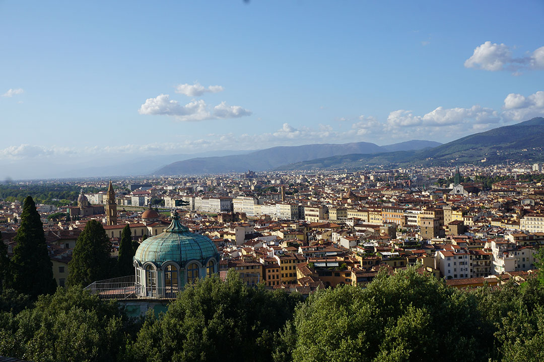 A panorama view of Florence, taken a top of Fort Belvedere. This picture exemplifies the city's structure due to the steep incline of the fortress. People are not visible in the city because of the incline, making the city look model-like.