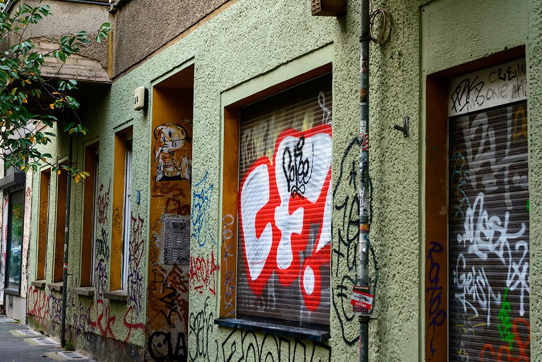 A graffitied house entrance in Prenzlauer Berg, Berlin, Germany