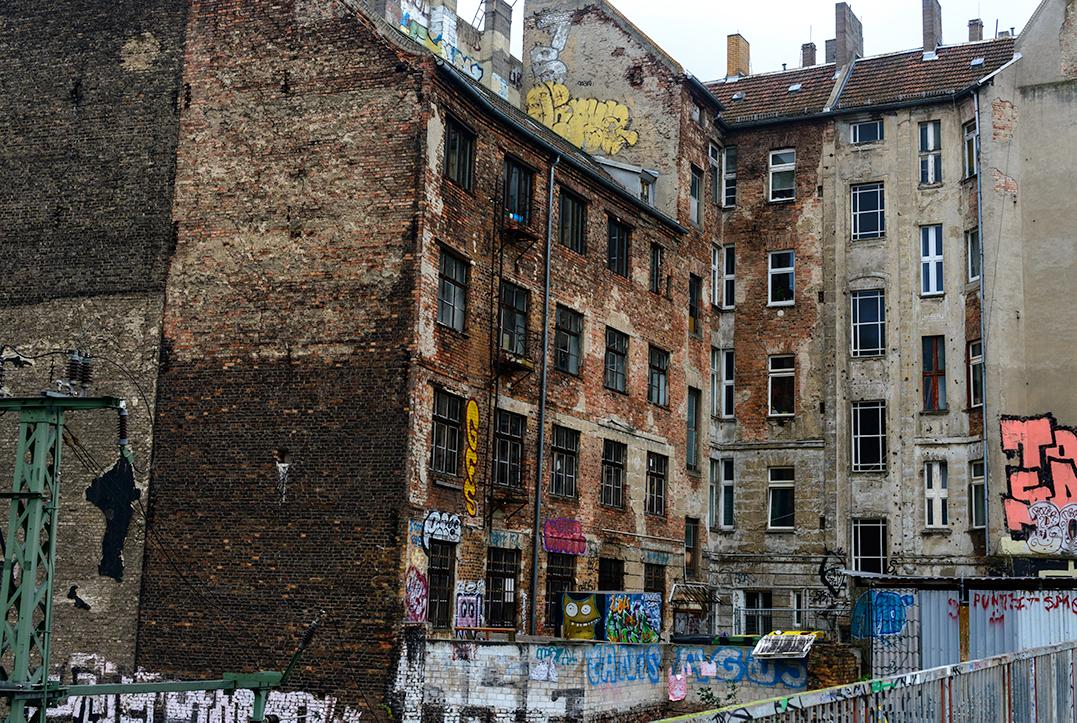 Old residential building covered in graffiti in Prenzlauer Berg, Berlin, Germany
