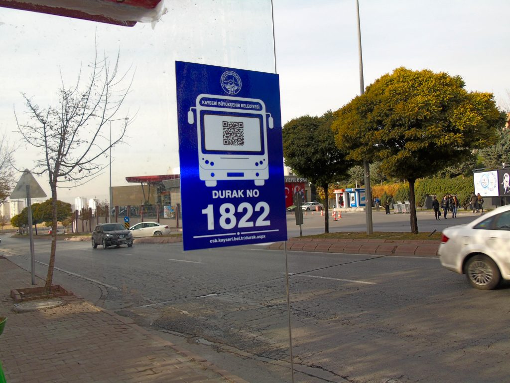 A plate with bar code (QR code) and bus stop number installed on the bus stop at Anayurt, Kayseri, Turkey