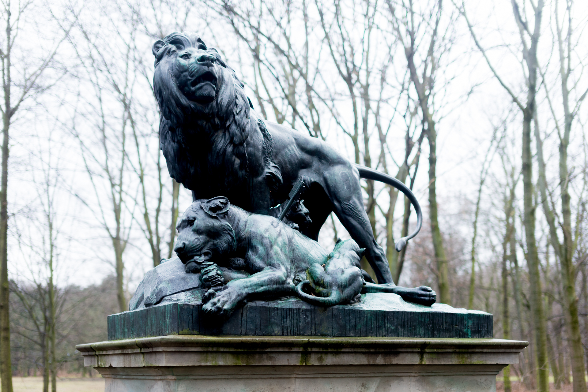 A lion statue that represents Tiergarten Park's hunting past in Berlin, Germany