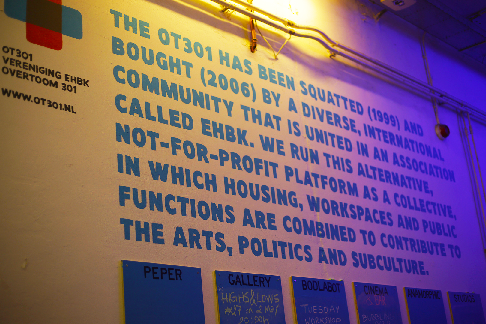 The history and values of OT301 are displayed on the entrance wall of the building along with the weekly events
